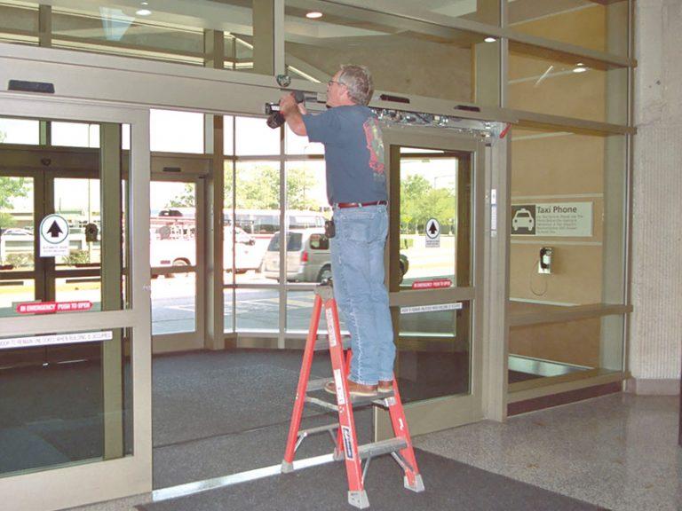Technician Performing Planned Maintenance Automatic Sliding Door